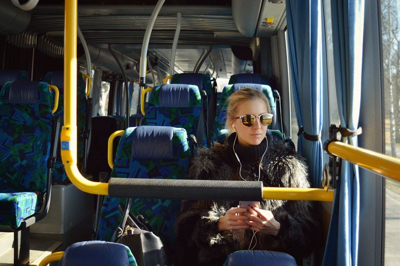 Young woman using a public bus